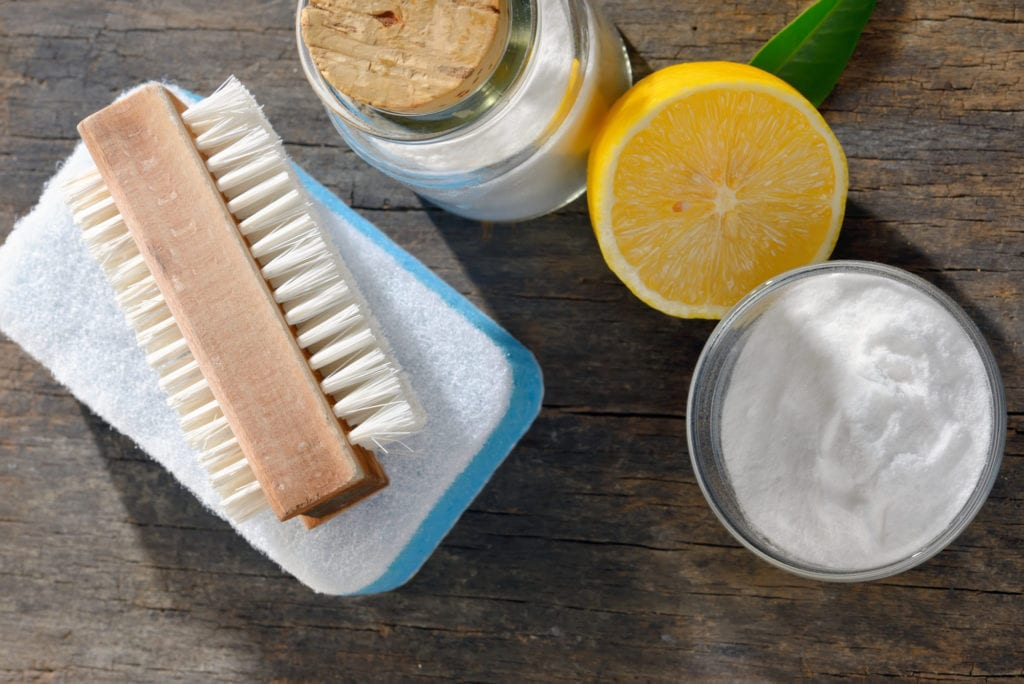 Baking soda, lemon and scrub brush