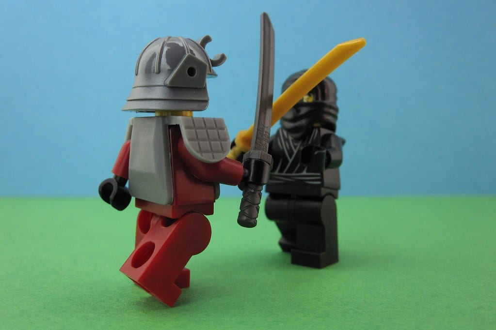 Two lego figurines dueling