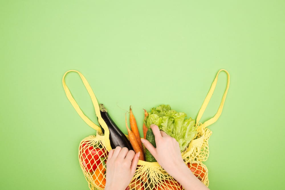yellow mesh grocery bag with produce